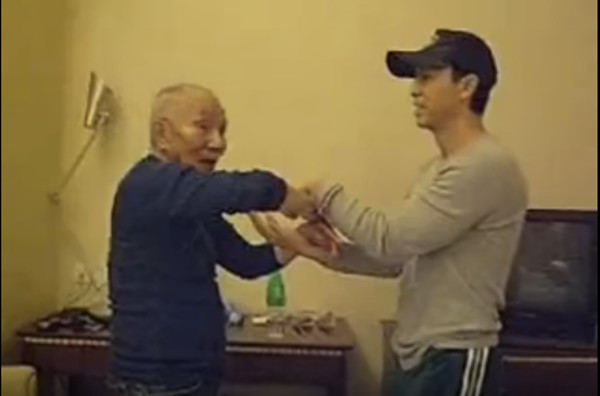 Ip Chun and Donnie Yen doing Chi Sao